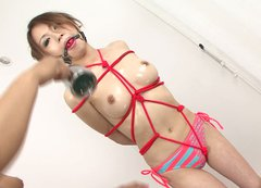 Luscious Japanese cutie gets bandaged before aroused fucker rubs her body