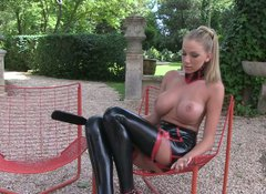 Auburn whore in latex stockings stuns with her long sexy legs