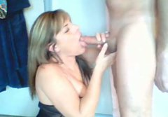 Foxy brunette wifey kneels down to oral fuck hard cock of her hubby