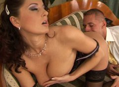 Arousing brunette milf Kate gives blowjob before riding stiff penis
