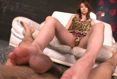 Mean Japanese woman Maki Hojo rubs her man's cock with her feet