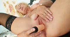 Emotional blond old nurse Greta polishes her quim with a sex toy ardently