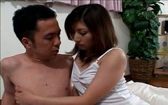 Frisky Japanese wench Hitomi Ikeno pleasures her man with her tits