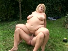 Too obese and too perverted blondie Cynthia rides a cock on the green lawn