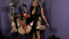 Stunning mistress Nicolette tortures her slave's balls with hot wax