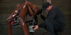 Oil covered black bitch Ana Foxxx gets used in BDSM way