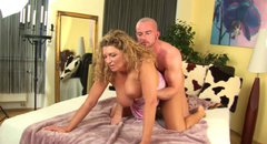 Curly chubby MILF Mika is doggyfucked by Markus Waxenegger