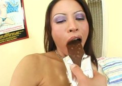 Slutty whore Jayna Oso eats a chocolate and gets rammed in her asshole by a black rod