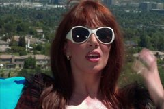 Redhead cougar Rayveness fucks sexy young pool boy outside