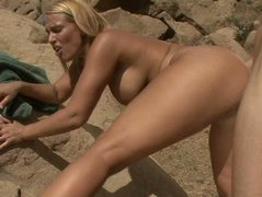 Sexy tanned wide hipped blonde Mellanie Monroe gets fucked on the rocks.