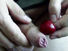 Uncut cock cumming twice on a cherry