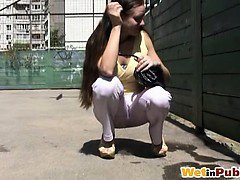 Chick lets hot pee trickle through pants