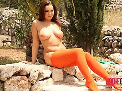 Jodie Gasson in her orange tights and green top.
