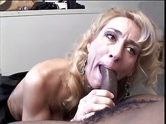 Attractive blonde milf fingers her cute ass blowing black dick