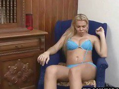 Busty blonde shemale gets naked and jerks off
