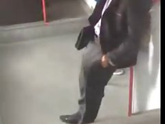 Businessman with a beautiful bulge in train...