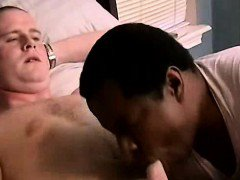 Amateur ebony hunk sucking on a hard white cock
