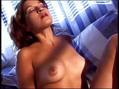 Brunette with nice tits spreads her legs and masturbates with both hands