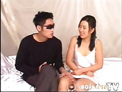 asian couple foreplay on bed