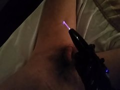 Violet wand on cock and balls.