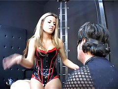 Latex Mistress lets dog slave out of the cage to be whipped