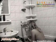 WEBCAM-blonde-on-camera-in-her-bathroom by www.x-rated.biz