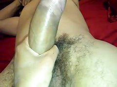 Showing her sucking skills on a dildo