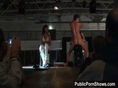 Handsome male stripper gets on the stage and pleasures two slutty girls