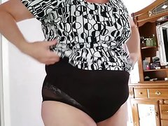 bbw wife putting on her black transparent girdle,
