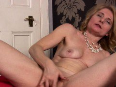 Hot MILF Isabella strips down and masturbates.