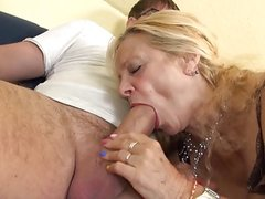 Busty GILF takes young cock in her old holes