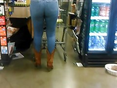 Phat ass in jeans and cowboy boots