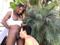 Busty black tranny toyed and sucked outdoors