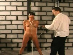 Horny slave gets boobs tied by rope in dungeon