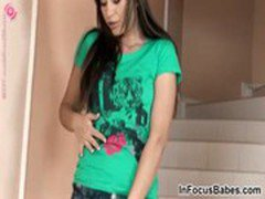 Lovely teen Lindsey gives a striptease