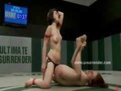 Sporty lesbian ladies fight for the right to stick strapon in the other pussy