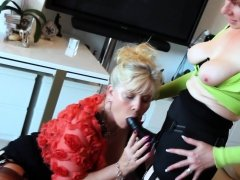 Horny MILFS fuck each other with strap-ons and toys