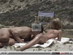 beautiful couple is having sex on the beach