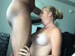 Amateur baclk mother giving a blowjob to a big black cock