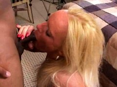 Sexy blonde with big tatas does blowjob in milf movie