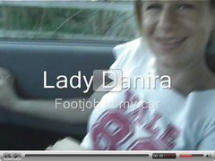 A footjob in nylons in the car