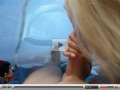 Cute blonde in a tent blows the dick to a huge thick cumshot