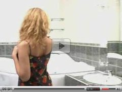 Sexy blonde girl masturbates in her bath
