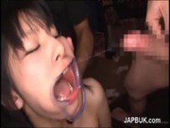 Japanese BDSM cumshot in wide open mouth