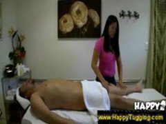 Asian masseuse puts her hand under the towel