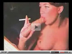 Whore Smokes Cigarette While Sucking A Sex Toy