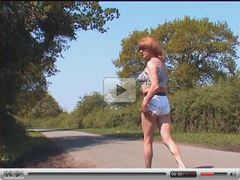 Zoe exhibitionist in her blue bikini outdoors on the road