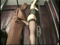 Hot tied slave with great body and beautiful ass is spanked on her ass in a dungeon by master priest
