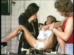 Scared girl tied to a chair got her hairy pussy shaved by two guy slaves and her mistress is watchin