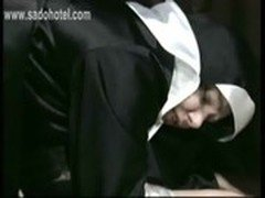 Horny nun got her panties down and spanked on her nice ass by a horny older priest